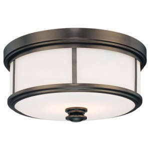 This Two Light Drum Shade Flush Mount has a Bronze Finish and is part of the Harvard Court Collection.